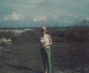 Mom at her beach.  This was the year she took a wig!