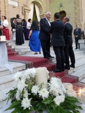 The bride's father greets guests